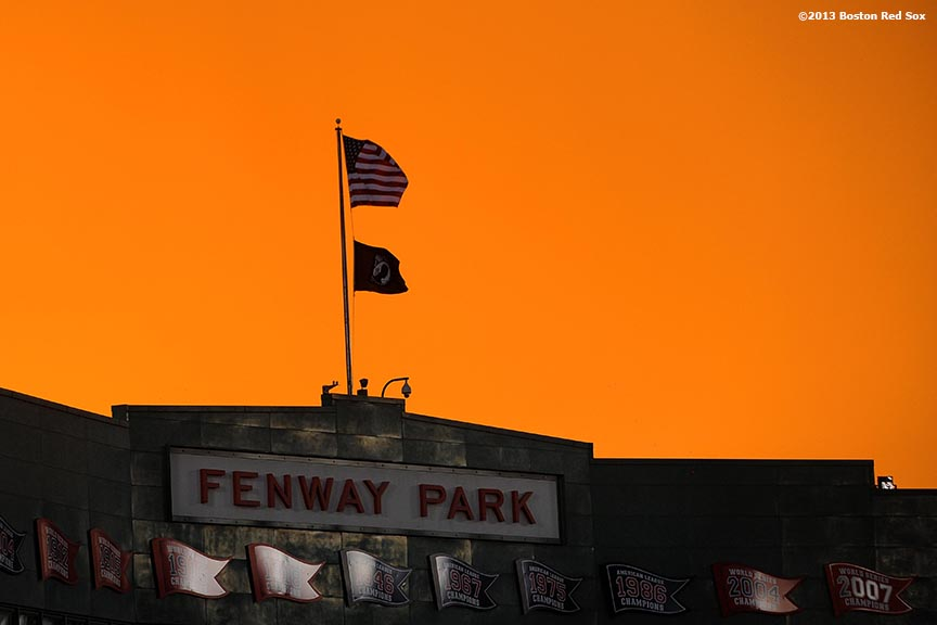 """""""The sun sets over Fenway Park during a team workout before game one of the 2013 World Series between the Boston Red Sox and the St. Louis Cardinals Tuesday, October 22, 2013 at Fenway Park in Boston, Massachusetts."""""""