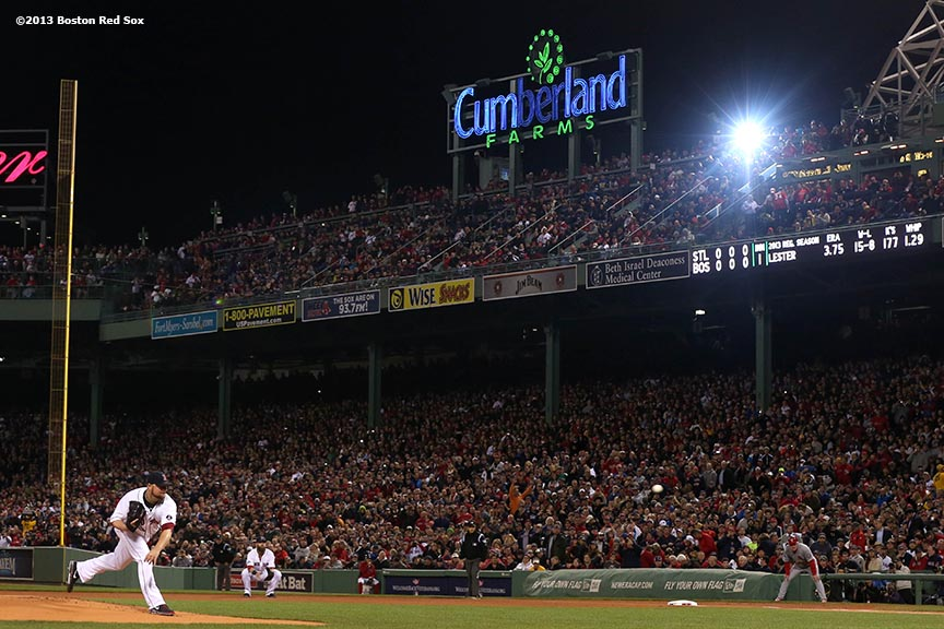 """Boston Red Sox pitcher Jon Lester delivers the first pitch of game one of the 2013 World Series against the St. Louis Cardinals Wednesday, October 23, 2013 at Fenway Park in Boston, Massachusetts."""