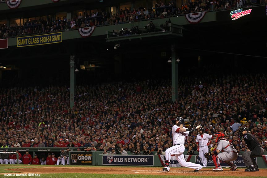 """Boston Red Sox first baseman Mike Napoli hits a bases clearing RBI double during the first inning of game one of the 2013 World Series against the St. Louis Cardinals Wednesday, October 23, 2013 at Fenway Park in Boston, Massachusetts."""
