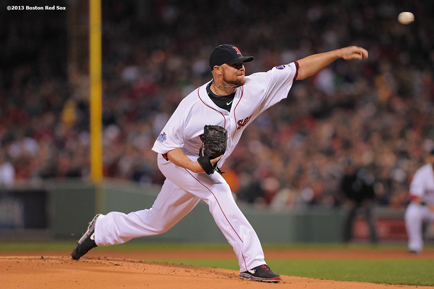 """Boston Red Sox pitcher Jon Lester delivers during the first inning of game one of the 2013 World Series against the St. Louis Cardinals Wednesday, October 23, 2013 at Fenway Park in Boston, Massachusetts."""
