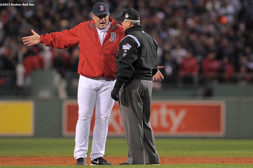 """Boston Red Sox manager John Farrell argues a call with second base umpire Dana DeMuth during the first inning of game one of the 2013 World Series against the St. Louis Cardinals Wednesday, October 23, 2013 at Fenway Park in Boston, Massachusetts."""