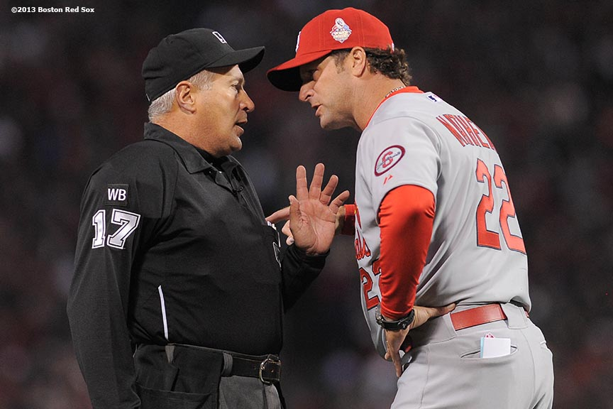 """St. Louis Cardinals manager Mike Matheny argues with umpire John Hirschbeck after Hirschbeck reversed  a blown call during the second inning of game one of the 2013 World Series against the Boston Red Sox Wednesday, October 23, 2013 at Fenway Park in Boston, Massachusetts."""