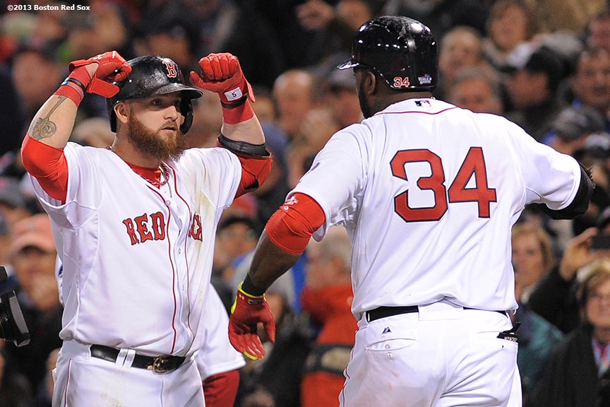 """Boston Red Sox right fielder Jonny Gomes celebrates with designated hitter David Ortiz after Ortiz hit a two run home run during the seventh inning of game one of the 2013 World Series against the St. Louis Cardinals at Fenway Park. Wednesday, October 23, 2013 at Fenway Park in Boston, Massachusetts."""