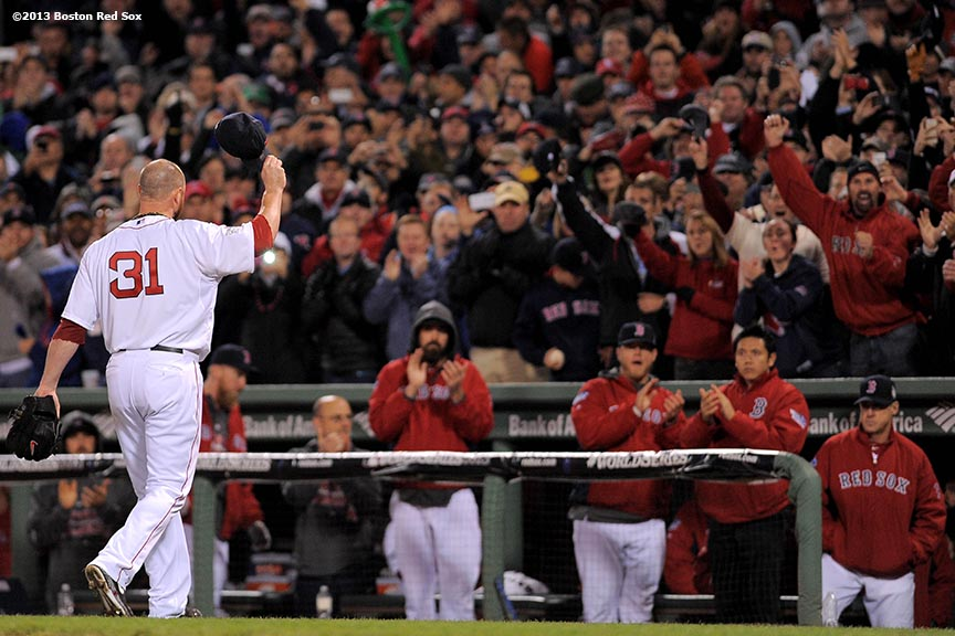 """Boston Red Sox pitcher Jon Lester gives a curtain call as he exits the game during the eighth inning of game one of the 2013 World Series against the St. Louis Cardinals Wednesday, October 23, 2013 at Fenway Park in Boston, Massachusetts."""