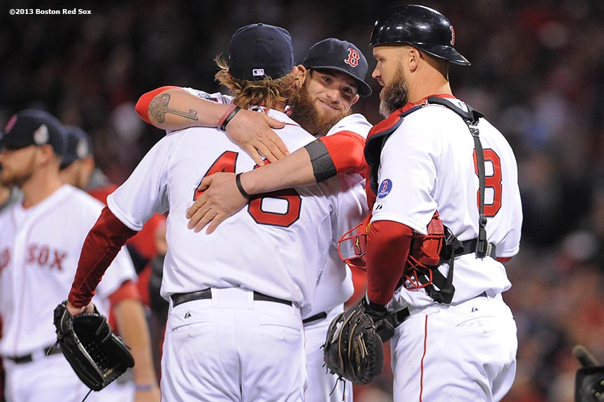"""Boston Red Sox left fielder Jonny Gomes hugs pitcher Ryan Dempster after winning game one of the 2013 World Series against the St. Louis Cardinals Wednesday, October 23, 2013 at Fenway Park in Boston, Massachusetts."""