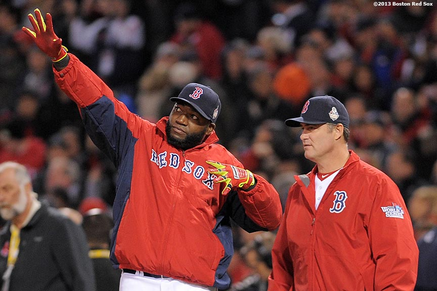 """Boston Red Sox designated hitter David Ortiz celebrates after defeating the St. Lousi Cardinals in  game one of the 2013 World Series Wednesday, October 23, 2013 at Fenway Park in Boston, Massachusetts."""