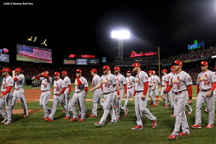 """The St. Louis Cardinals leave the field after a pre-game ceremony before game one of the 2013 World Series between the Boston Red Sox and the St. Louis Cardinals Wednesday, October 23, 2013 at Fenway Park in Boston, Massachusetts."""