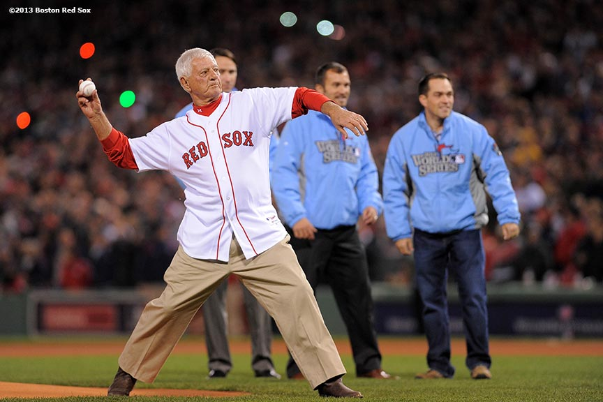 """Former Boston Red Sox player Carl Yastrzemski throws out the ceremonial first pitch alongside Medal Of Honor recipients before throwing out the ceremonial first pitch during a pre-game ceremony before game one of the 2013 World Series between the Boston Red Sox and the St. Louis Cardinals Wednesday, October 23, 2013 at Fenway Park in Boston, Massachusetts."""