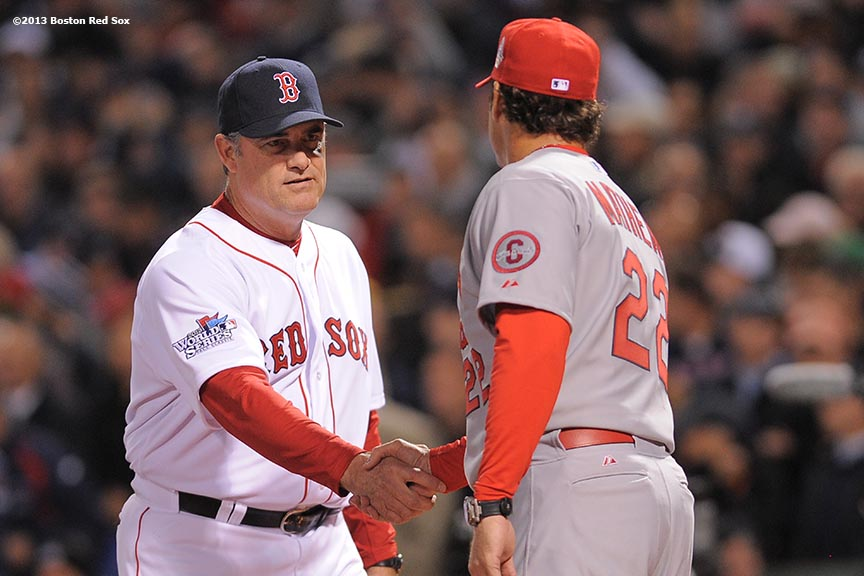 """Boston Red Sox manager John Farrell shakes hands with St. Louis Cardinals manager Mike Matheny during a pre-game ceremony before game one of the 2013 World Series Wednesday, October 23, 2013 at Fenway Park in Boston, Massachusetts."""