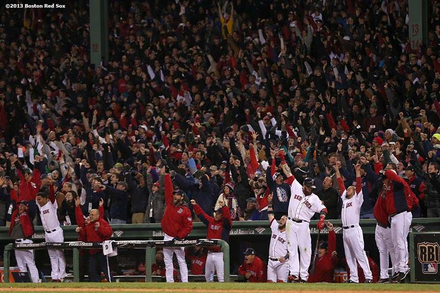 """Boston Red Sox players react as designated hitter David Ortiz hits a two-run home run during the sixth inning of game two of the 2013 World Series between against the St. Louis Cardinals Thursday, October 24, 2013 at Fenway Park in Boston, Massachusetts."""