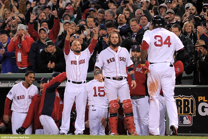 """Boston Red Sox right fielder Shane Victorino and catcher Jarrod Saltalamacchia congratulate designated hitter David Ortiz after Ortiz hit a two-run home run during the sixth inning of game two of the 2013 World Series between against the St. Louis Cardinals Thursday, October 24, 2013 at Fenway Park in Boston, Massachusetts."""