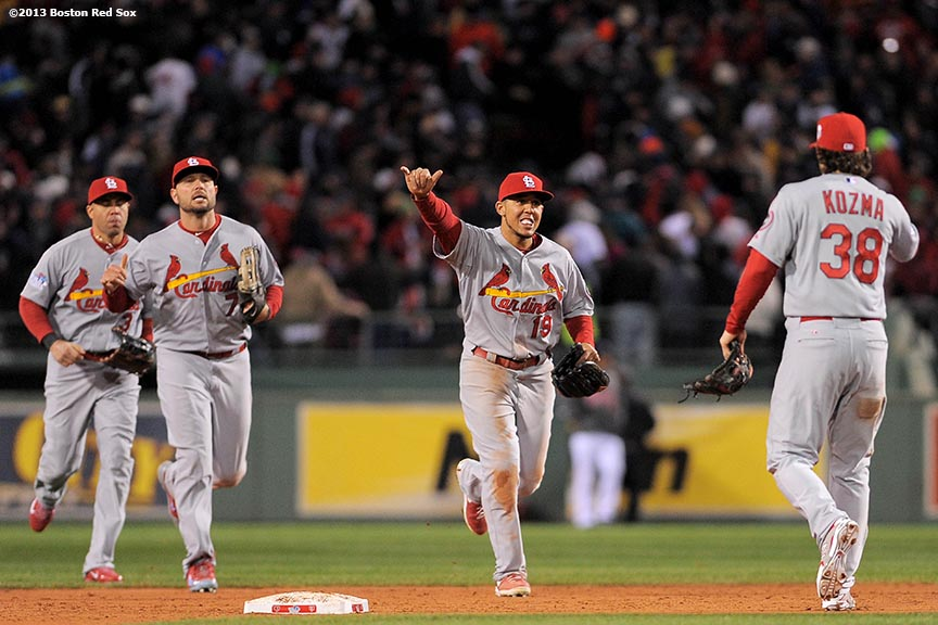 """St. Louis Cardinals center fielder John Jay high fives teammates after defeating the Boston Red Sox in game two of the 2013 World Series Thursday, October 24, 2013 at Fenway Park in Boston, Massachusetts."""