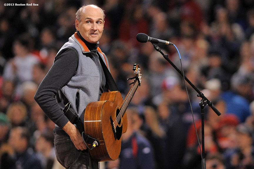 """Singer James Taylor is introduced before singing the National Anthem during a pre-game ceremony before game two of the 2013 World Series between the Boston Red Sox and the St. Louis Cardinals Thursday, October 24, 2013 at Fenway Park in Boston, Massachusetts."""
