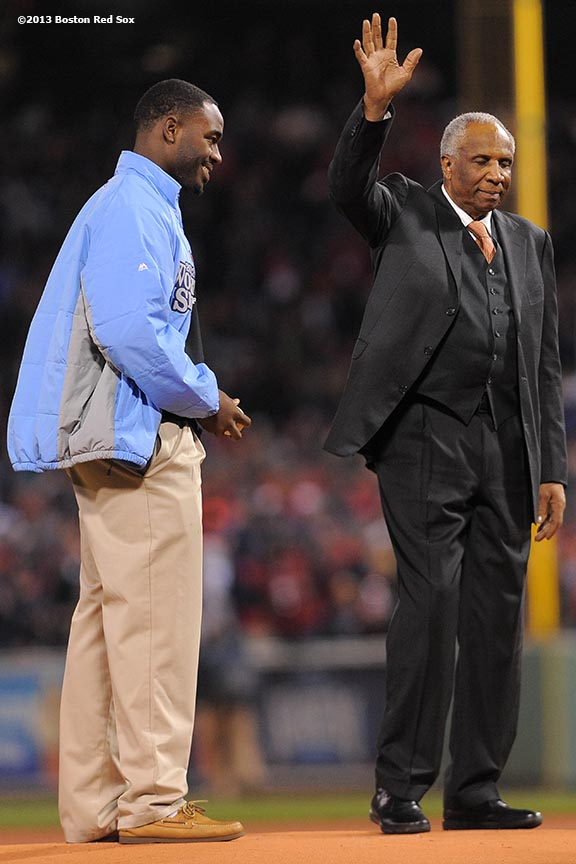 """""""Former player and manager Frank Robinson is introduced alongside a Boys & Girls Club recipient during the game ball delivery pre-game ceremony before game two of the 2013 World Series between the Boston Red Sox and the St. Louis Cardinals Thursday, October 24, 2013 at Fenway Park in Boston, Massachusetts."""""""