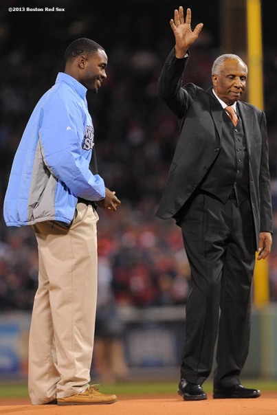 """Former player and manager Frank Robinson is introduced alongside a Boys & Girls Club recipient during the game ball delivery pre-game ceremony before game two of the 2013 World Series between the Boston Red Sox and the St. Louis Cardinals Thursday, October 24, 2013 at Fenway Park in Boston, Massachusetts."""