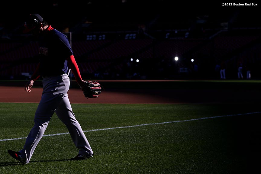"""Boston Red Sox pitcher Junichi Tazawa walks toward left field before game three of the 2013 World Series against the St. Louis Cardinals Saturday, October 26, 2013 at Busch Stadium in St. Louis, Missouri."""