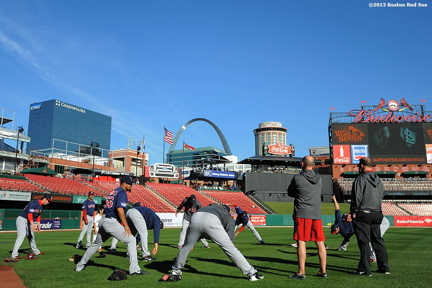 """Boston Red Sox pitchers stretch before game three of the 2013 World Series against the St. Louis Cardinals Saturday, October 26, 2013 at Busch Stadium in St. Louis, Missouri."""