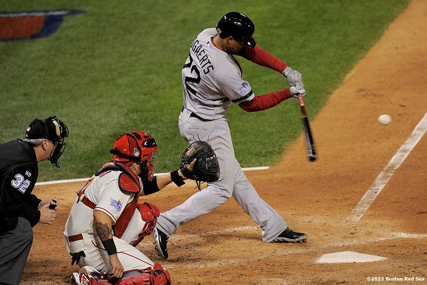 """Boston Red Sox third baseman Xander Bogaerts hits a triple during the fifth inning of game three of the 2013 World Series against the St. Louis Cardinals Saturday, October 26, 2013 at Busch Stadium in St. Louis, Missouri."""