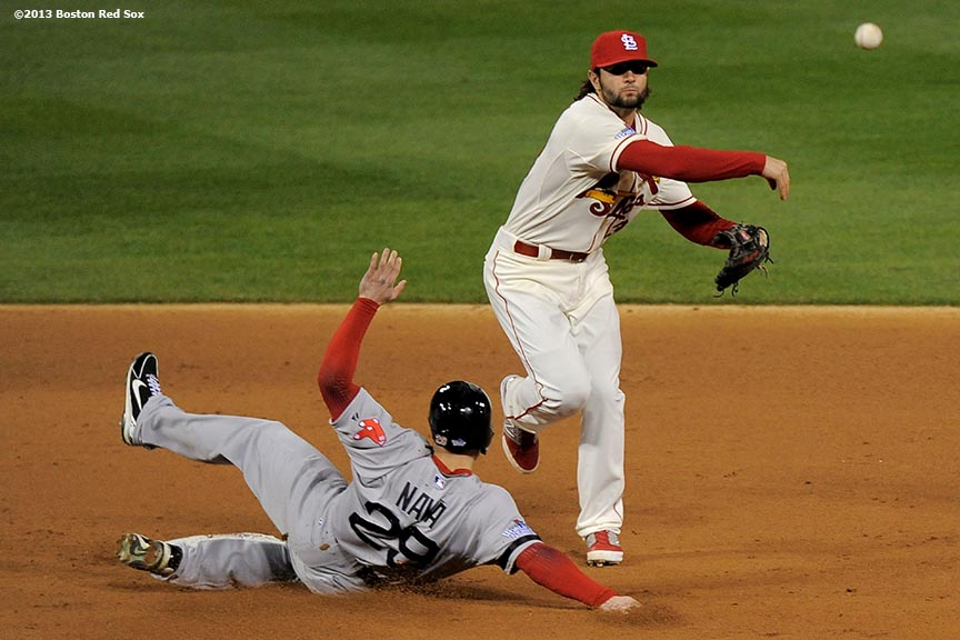 """Boston Red Sox left fielder Daniel Nava slides into second base as shortstop Pete Kozma turns a double play during the sixth inning of game three of the 2013 World Series against the St. Louis Cardinals Saturday, October 26, 2013 at Busch Stadium in St. Louis, Missouri."""