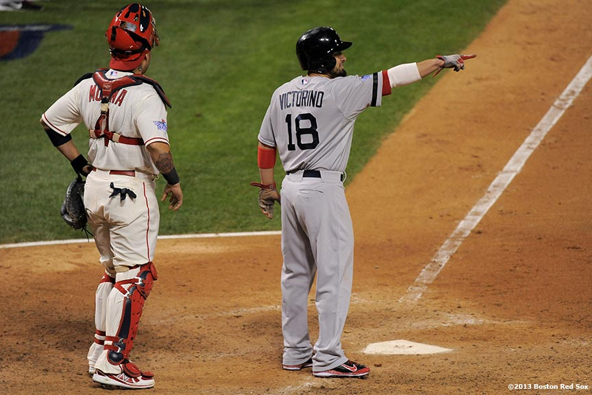 """Boston Red Sox right fielder Shane Victorino points as he scores during the eighth inning of game three of the 2013 World Series against the St. Louis Cardinals Saturday, October 26, 2013 at Busch Stadium in St. Louis, Missouri."""