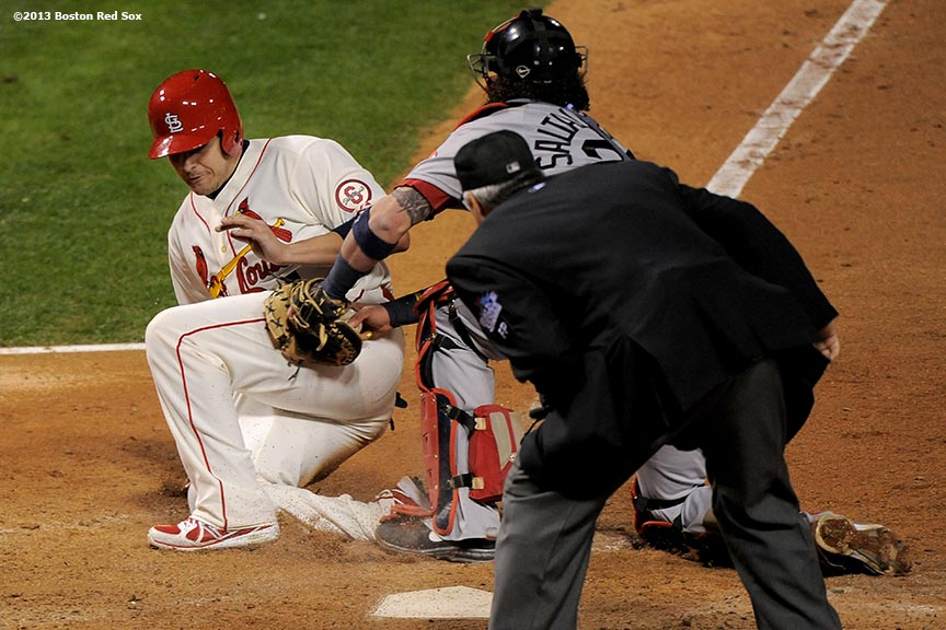 """Boston Red Sox catcher Jarrod Saltalamacchia tags out catcher Yadier Molina during the ninth inning of game three of the 2013 World Series against the St. Louis Cardinals Saturday, October 26, 2013 at Busch Stadium in St. Louis, Missouri."""