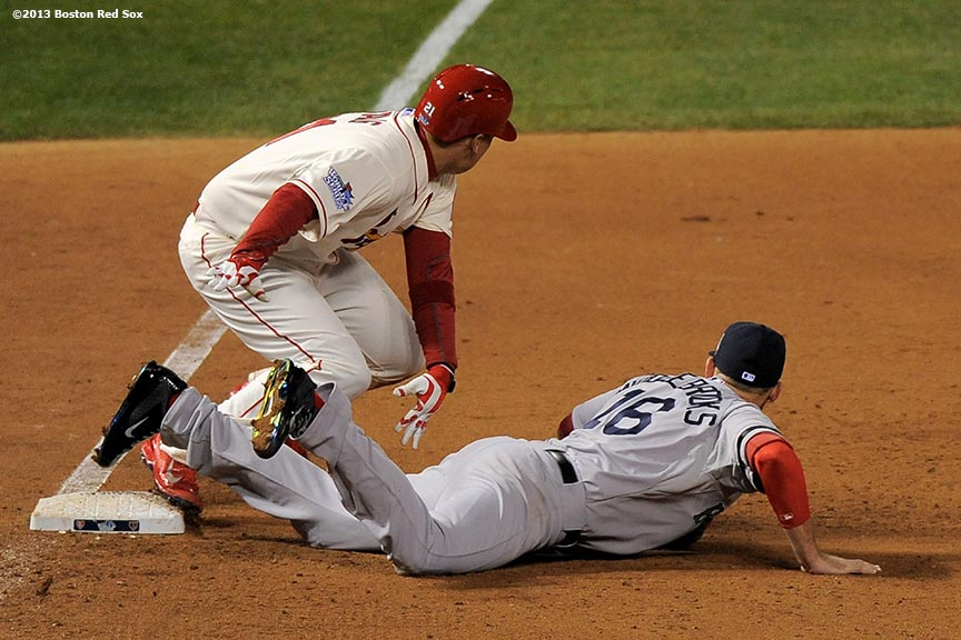 """Boston Red Sox third baseman Will Middlebrooks is called for an interference error as St. Louis Cardinals infielder Allen Craig runs toward home to score the game winning run during the ninth inning of game three of the 2013 World Series  Saturday, October 26, 2013 at Busch Stadium in St. Louis, Missouri."""