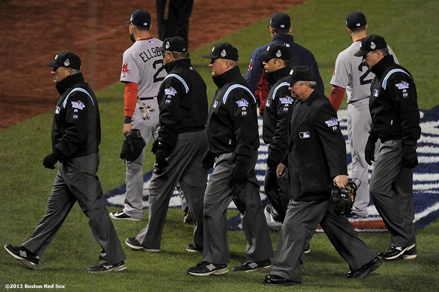 """Umpires walk off the field after the St. Louis Cardinals defeated the Boston Red Sox in game three of the 2013 World Series on a fielder's interference call in the ninth inning by third base umpire Jim Joyce Saturday, October 26, 2013 at Busch Stadium in St. Louis, Missouri."""