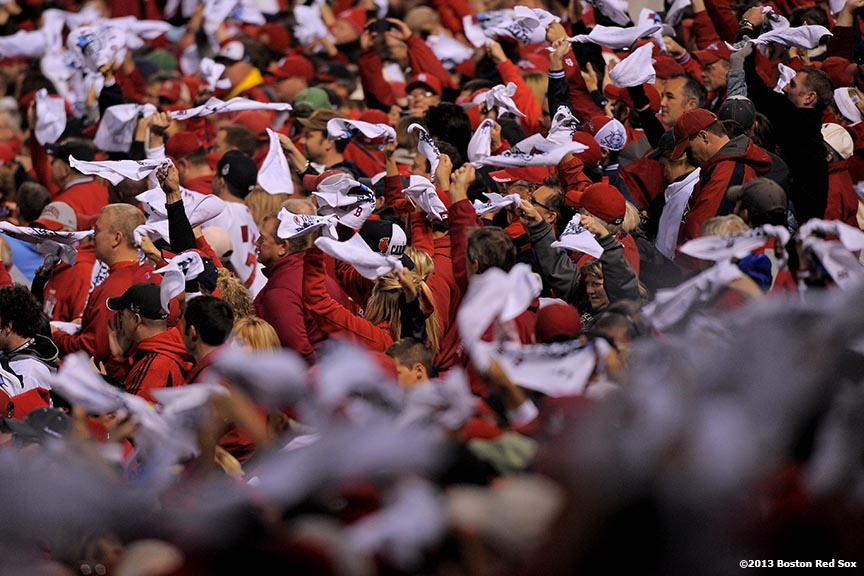 """Fans wave towels during a pre-game ceremony before game three of the 2013 World Series between the Boston Red Sox and the St. Louis Cardinals Saturday, October 26, 2013 at Busch Stadium in St. Louis, Missouri."""