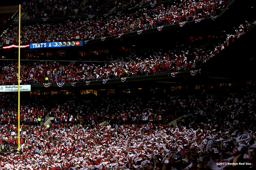 """Fans wave towels before game four of the 2013 World Series between the Boston Red Sox and the St. Louis Cardinals Sunday, October 27, 2013 at Busch Stadium in St. Louis, Missouri."""