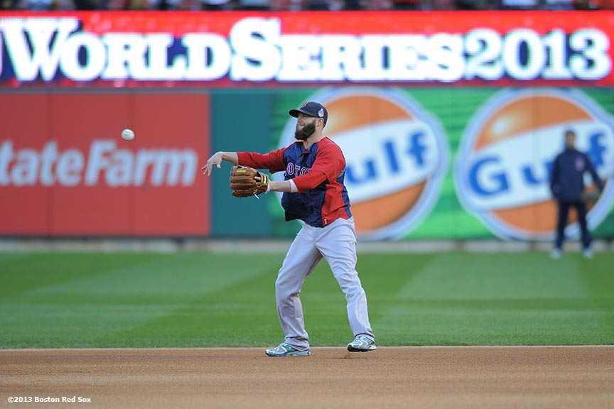 """Boston Red Sox second baseman Dustin Pedroia takes ground balls before game four of the 2013 World Series against the St. Louis Cardinals Sunday, October 27, 2013 at Busch Stadium in St. Louis, Missouri."""