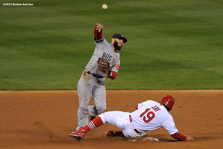 """Boston Red Sox second baseman Dustin Pedroia turns a double play over center fielder John Jay during the fourth inning of game four of the 2013 World Series against the St. Louis Cardinals Sunday, October 27, 2013 at Busch Stadium in St. Louis, Missouri."""