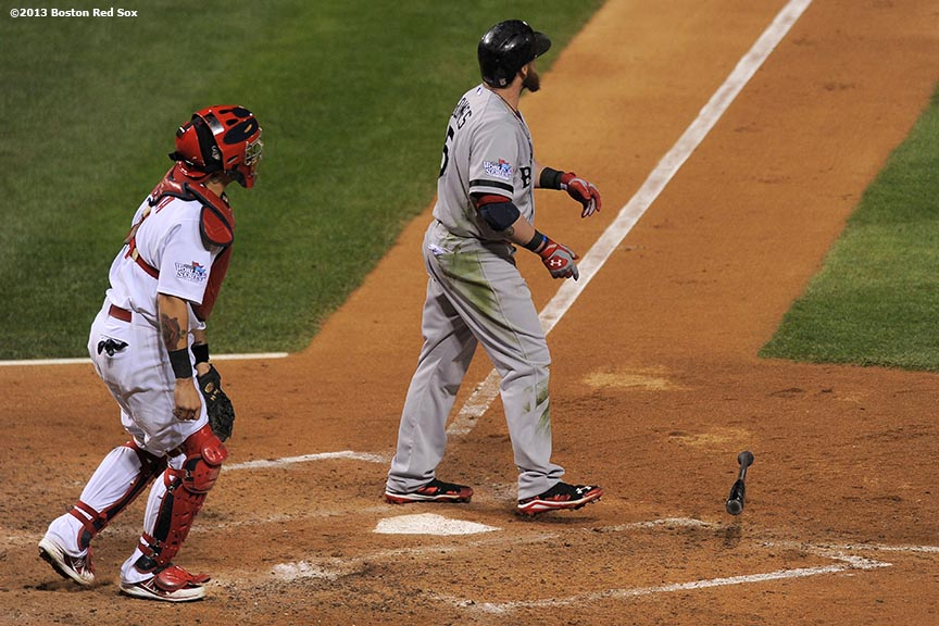 """Boston Red Sox left fielder Jonny Gomes hits a go-ahead three run home run during the sixth inning of game four of the 2013 World Series against the St. Louis Cardinals Sunday, October 27, 2013 at Busch Stadium in St. Louis, Missouri."""