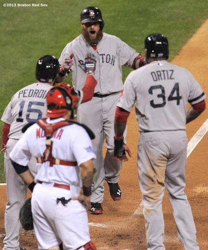 """Boston Red Sox left fielder Jonny Gomes celebrates after hitting a go-ahead three run home run during the sixth inning of game four of the 2013 World Series against the St. Louis Cardinals Sunday, October 27, 2013 at Busch Stadium in St. Louis, Missouri."""