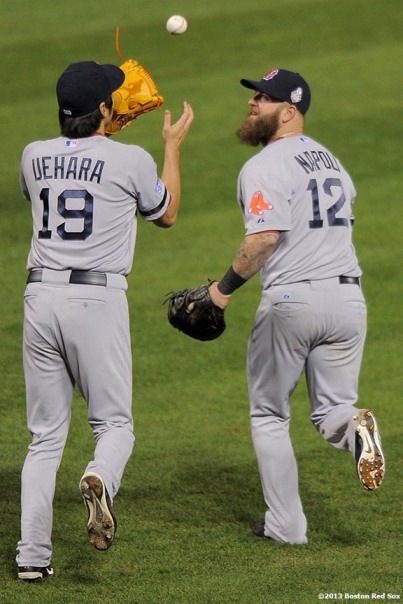 """Boston Red Sox first baseman Mike Napoli and pitcher Koji Uehara celebrates after recording the final out of game four of the 2013 World Series by picking off St. Louis Cardinals pinch runner Kolten Wong during the ninth inning Sunday, October 27, 2013 at Busch Stadium in St. Louis, Missouri."""