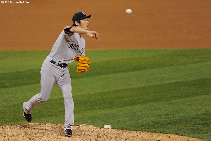 """""""Boston Red Sox pitcher Koji Uehara records the final out of game four of the 2013 World Series as he picks off St. Louis Cardinals pinch runner Kolten Wong during the ninth inning Sunday, October 27, 2013 at Busch Stadium in St. Louis, Missouri."""""""