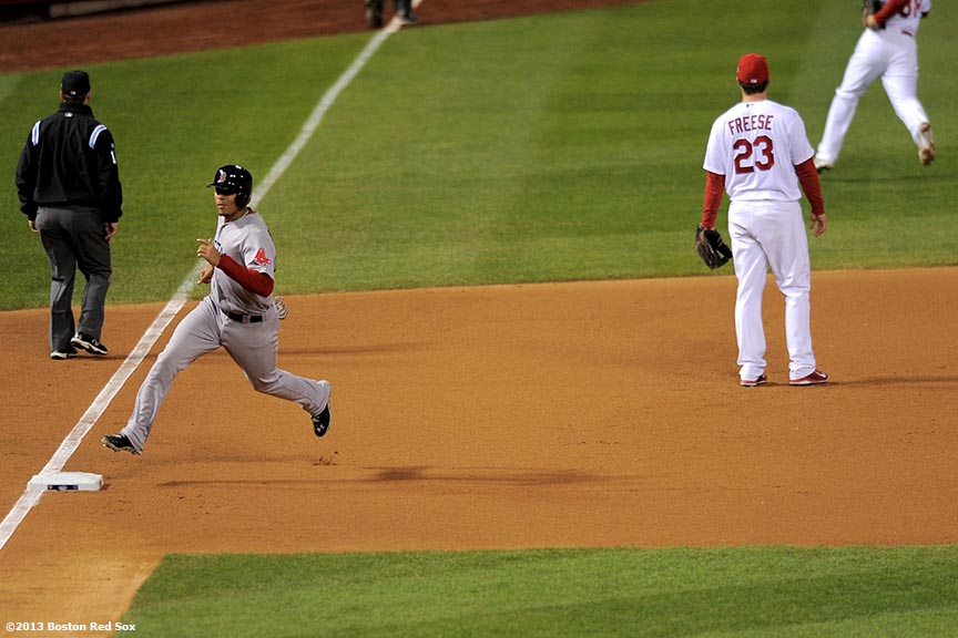 """Boston Red Sox third baseman Xander Bogaerts scores on an RBI double by catcher David Ross during the seventh inning of game five of the 2013 World Series against the St. Louis Cardinals Monday, October 28, 2013 at Busch Stadium in St. Louis, Missouri."""
