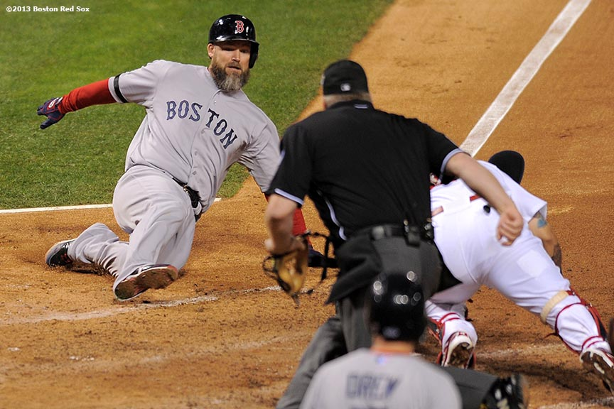 """Boston Red Sox shortstop catcher David Ross is tagged out while attempting to score on an RBI single by center fielder Jacoby Ellsbury during the seventh inning of game five of the 2013 World Series against the St. Louis Cardinals Monday, October 28, 2013 at Busch Stadium in St. Louis, Missouri."""