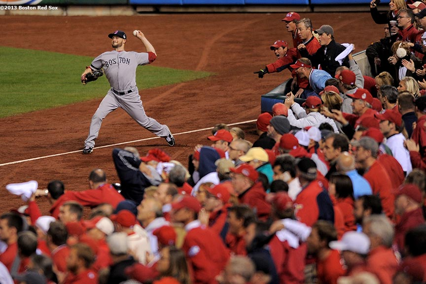 """Boston Red Sox right fielder Daniel Nava throws to second base during the eighth inning of game five of the 2013 World Series against the St. Louis Cardinals Monday, October 28, 2013 at Busch Stadium in St. Louis, Missouri."""
