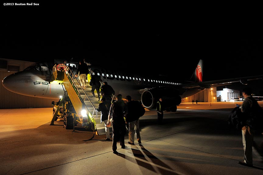 """Members of the Boston Red Sox front office board an airplane at Lambert-St. Louis International Airport in St. Louis, Missouri Tuesday, October 29, 2013 after game four of the 2013 World Series between the Boston Red Sox and the St. Louis Cardinals."""