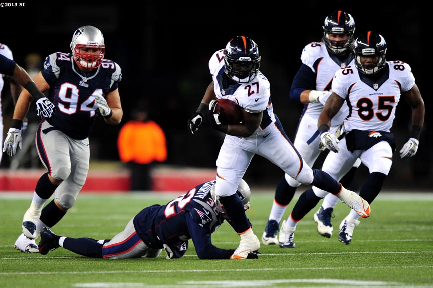 """Denver Broncos running back Knowshon Moreno carries the ball during a game against the New England Patriots Sunday, November 24, 2013 at Gillette Stadium in Foxborough, Massachusetts."""