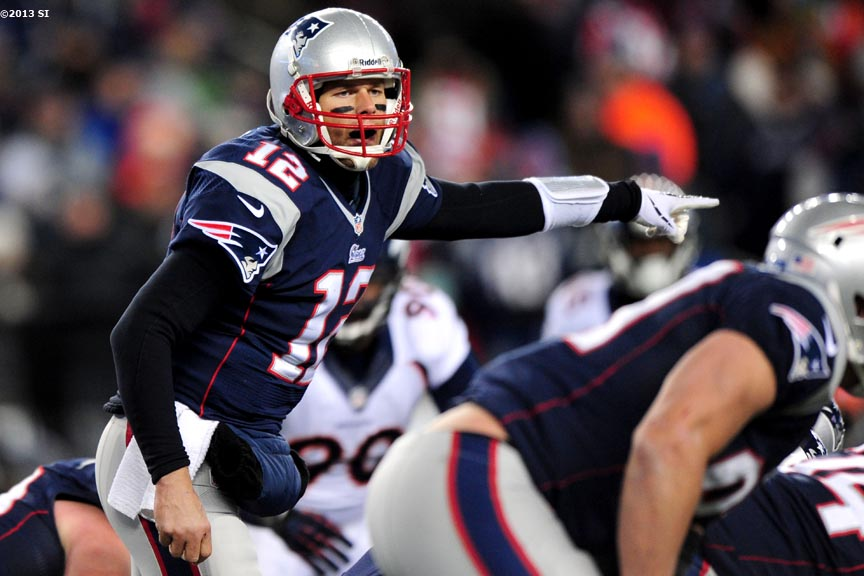 """New England Patriots quarterback Tom Brady calls plays at the line of scrimmage during a game against the Denver Broncos Sunday, November 24, 2013 at Gillette Stadium in Foxborough, Massachusetts."""