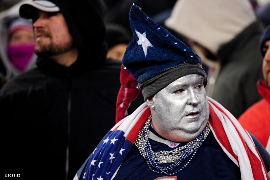 """A New England Patriots fan reacts during a game against the Denver Broncos Sunday, November 24, 2013 at Gillette Stadium in Foxborough, Massachusetts."""