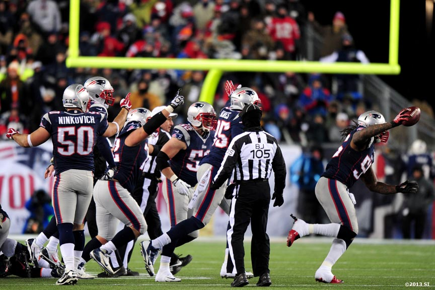 """New England Patriots players react after recovering a fumble against the Denver Broncos Sunday, November 24, 2013 at Gillette Stadium in Foxborough, Massachusetts."""