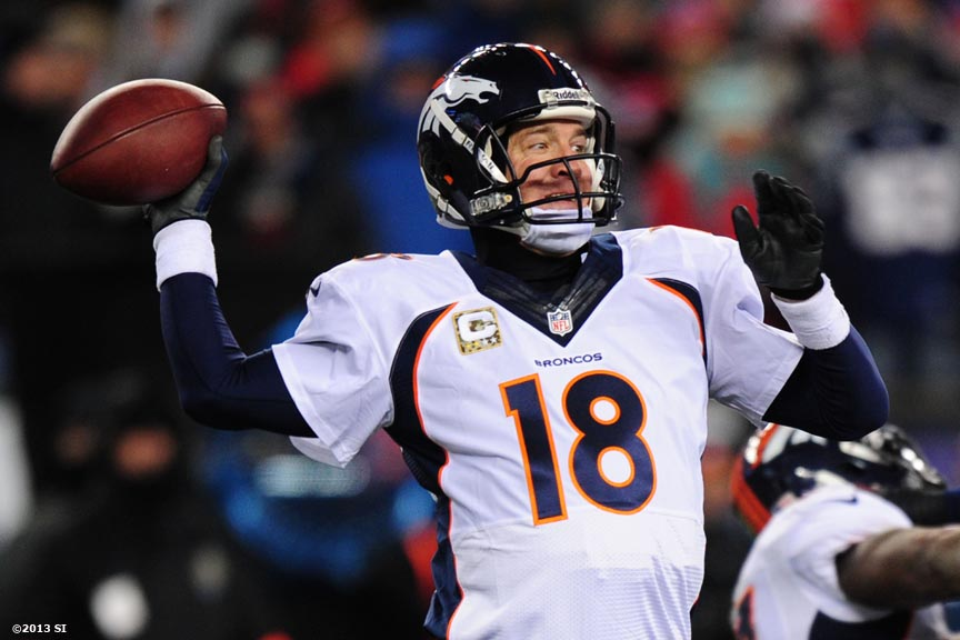 """Denver Broncos quarterback Peyton Manning throws a pass during a game against the New England Patriots Sunday, November 24, 2013 at Gillette Stadium in Foxborough, Massachusetts."""
