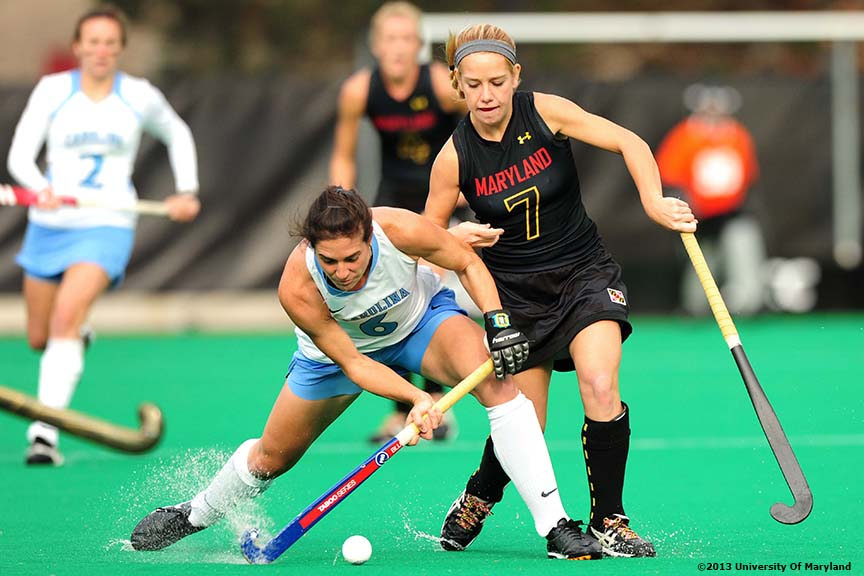 """University of Maryland foreword Emma Rissinger defends University of North Carolina Midfielder Tayler Evans during the ACC Field Hockey Conference Championship game Sunday, November 10, 2013 at Boston College in Newton, Massachusetts."""