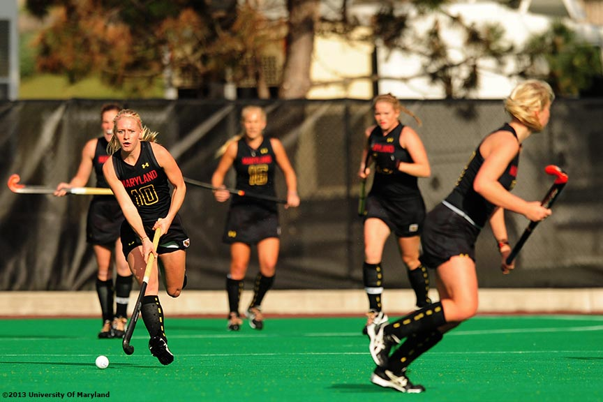 """University of Maryland foreword Jill Witmer advances up field during the ACC Field Hockey Conference Championship game against the University of North Carolina Sunday, November 10, 2013 at Boston College in Newton, Massachusetts."""