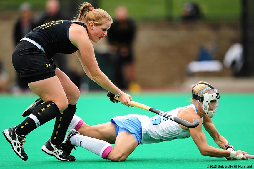 """University of Maryland defender Sarah Sprink defends University of North Carolina back Abby Frey during the ACC Field Hockey Conference Championship game Sunday, November 10, 2013 at Boston College in Newton, Massachusetts."""