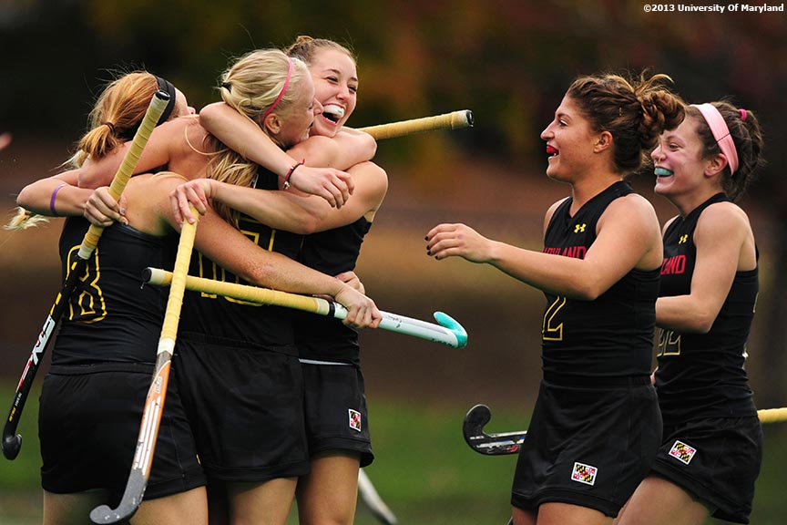 """University of Maryland foreword Alyssa Parker (center) celebrates with teammates after Maryland scored a goal during the ACC Field Hockey Conference Championship game against the University of North Carolina Sunday, November 10, 2013 at Boston College in Newton, Massachusetts."""