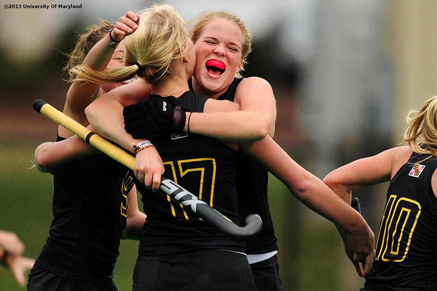 """University of Maryland defender Sarah Sprink celebrates with teammates after Maryland scored a goal during the ACC Field Hockey Conference Championship game against the University of North Carolina Sunday, November 10, 2013 at Boston College in Newton, Massachusetts."""
