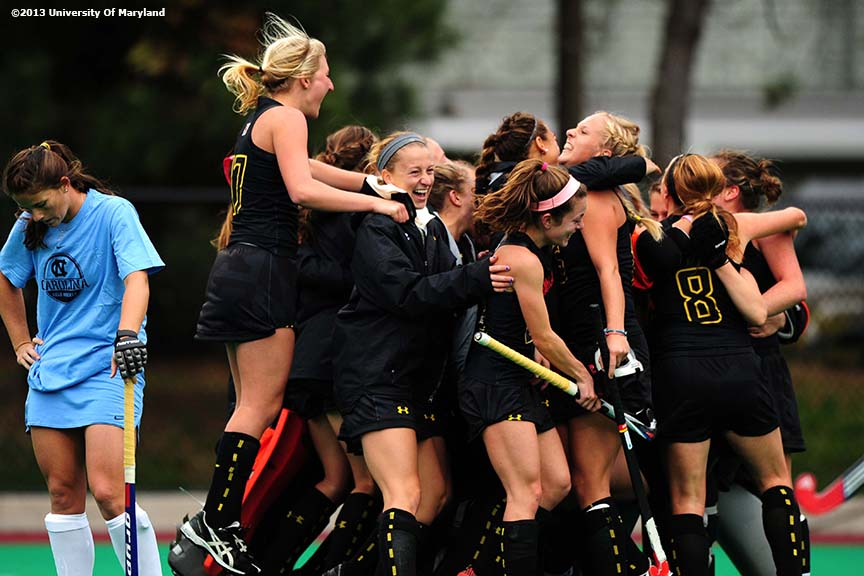 """The University of Maryland field hockey team celebrates after defeating the University of North Carolina to win the ACC Field Hockey Conference Championship game Sunday, November 10, 2013 at Boston College in Newton, Massachusetts."""